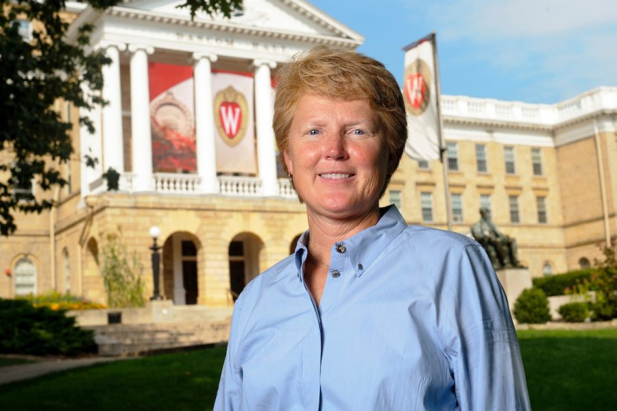Headshot of Lori Berquam, the dean of students, standing in front of Bascom Hall